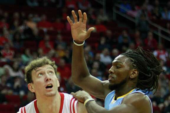 Rockets center Omer Asik, left, had 18 points on 6-for-11 shooting against Kenneth Faried and the Nuggets in an OT win Sunday night.