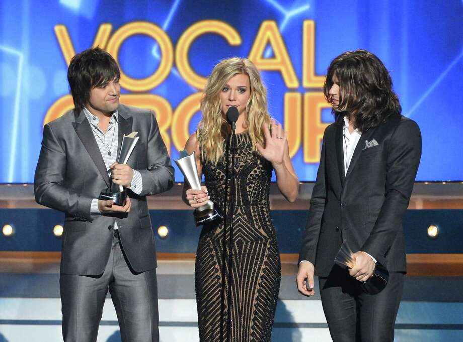 LAS VEGAS, NV - APRIL 06:  (L-R) Musicians Neil Perry, Kimberly Perry and Reid Perry of The Band Perry accept the Vocal Group of the Year award onstage during the 49th Annual Academy Of Country Music Awards at the MGM Grand Garden Arena on April 6, 2014 in Las Vegas, Nevada. Photo: Ethan Miller, Getty Images / 2014 Getty Images