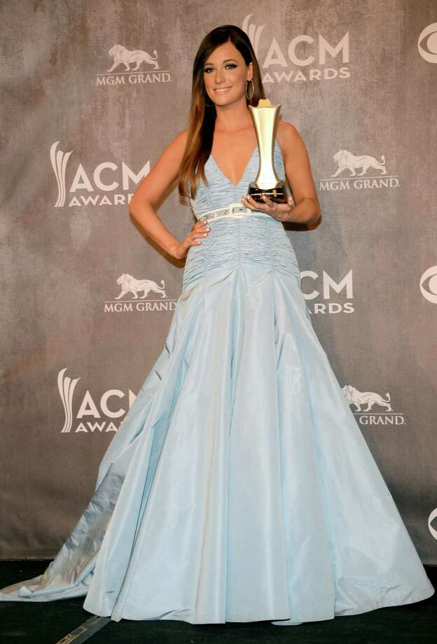Kacey Musgraves poses in the press room with the award for album of the year at the 49th annual Academy of Country Music Awards at the MGM Grand Garden Arena on Sunday, April 6, 2014, in Las Vegas. (Photo by Al Powers/Powers Imagery/Invision/AP) Photo: Al Powers/Powers Imagery, Associated Press / Invision