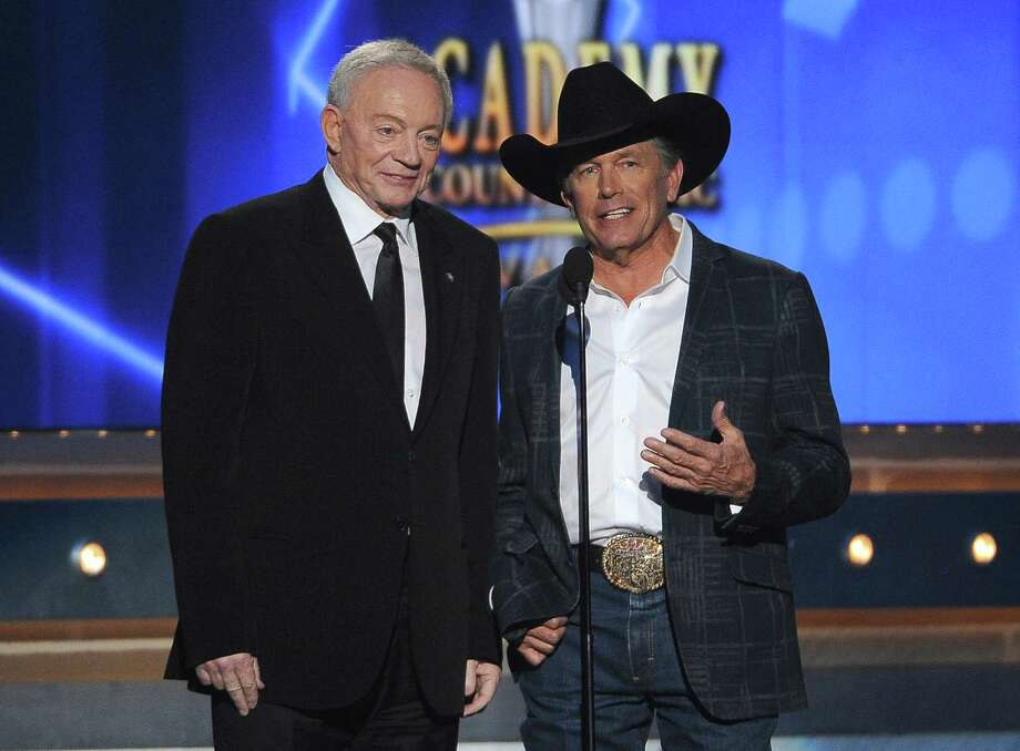 Jerry Jones, left, and George Strait speak on stage at the 49th annual Academy of Country Music Awards at the MGM Grand Garden Arena on Sunday, April 6, 2014, in Las Vegas. (Photo by Chris Pizzello/Invision/AP) Photo: Chris Pizzello, Associated Press / Invision