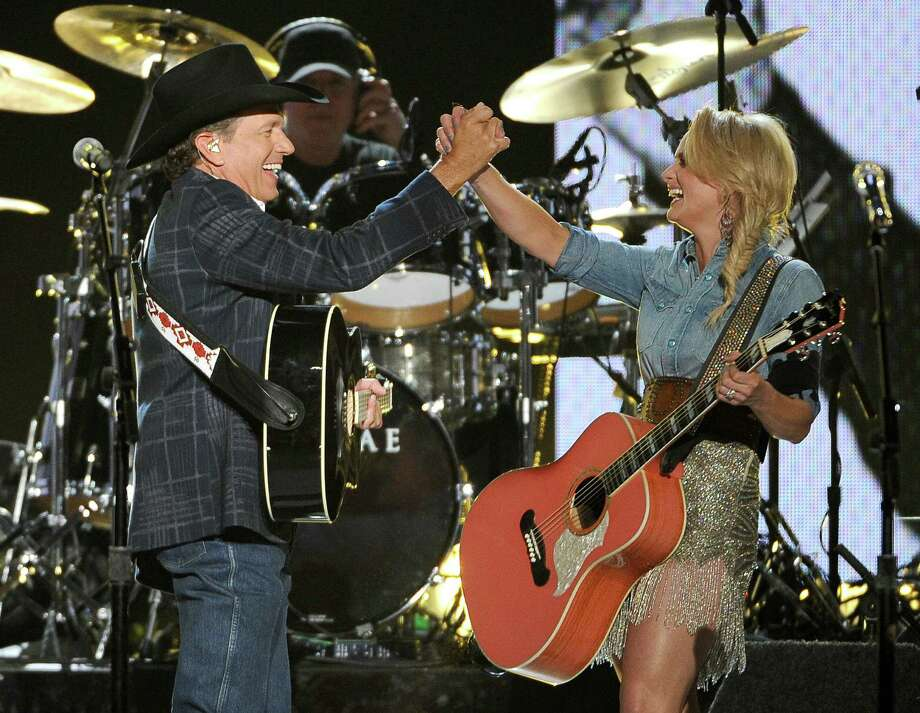 George Strait, left, and Miranda Lambert perform on stage at the 49th annual Academy of Country Music Awards at the MGM Grand Garden Arena on Sunday, April 6, 2014, in Las Vegas. (Photo by Chris Pizzello/Invision/AP) Photo: Chris Pizzello, Associated Press / Invision