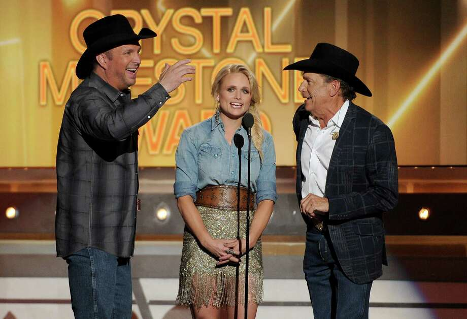 Garth Brooks, Miranda Lambert and George Strait speak on stage at the 49th annual Academy of Country Music Awards at the MGM Grand Garden Arena on Sunday, April 6, 2014, in Las Vegas. (Photo by Chris Pizzello/Invision/AP) Photo: Chris Pizzello, Associated Press / Invision
