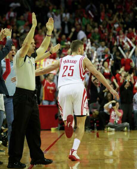 Chandler Parsons celebrates hitting a 3-pointer in overtime of the Rockets' victory over the Nuggets on Sunday night. He had eight of his 15 points in overtime. Photo: Melissa Phillip, Staff / © 2014  Houston Chronicle