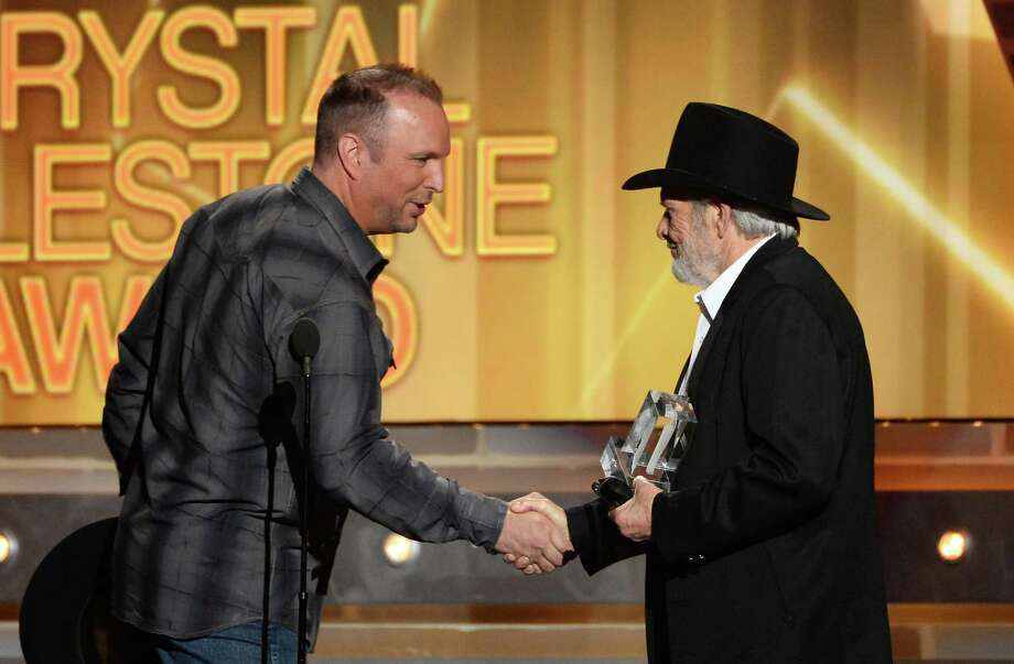 LAS VEGAS, NV - APRIL 06:  Singer/songwriter Merle Haggard (R) accepts the ACM Crystal Milestone Award from singer-songwriter Garth Brooks (L) onstage during the 49th Annual Academy Of Country Music Awards at the MGM Grand Garden Arena on April 6, 2014 in Las Vegas, Nevada. Photo: Ethan Miller, Getty Images / 2014 Getty Images