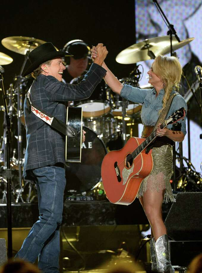 LAS VEGAS, NV - APRIL 06:  Singer/songwriters George Strait and Miranda Lambert perform onstage during the 49th Annual Academy Of Country Music Awards at the MGM Grand Garden Arena on April 6, 2014 in Las Vegas, Nevada. Photo: Ethan Miller, Getty Images / 2014 Getty Images