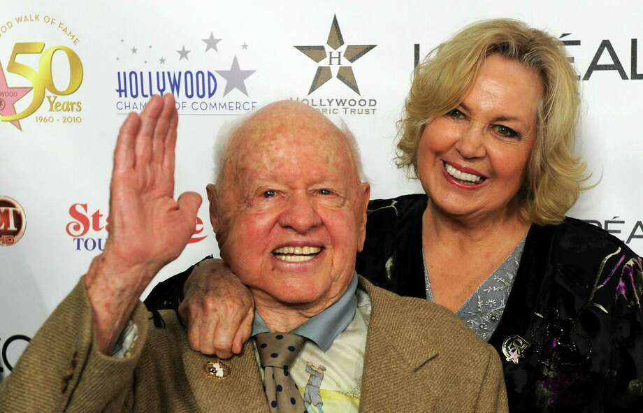 Actor Mickey Rooney and his wife, Jan, arrive on the red carpet for the 50th anniversary birthday bash for the Hollywood Walk of Fame in 2010. Photo: MARK RALSTON, Staff / AFP