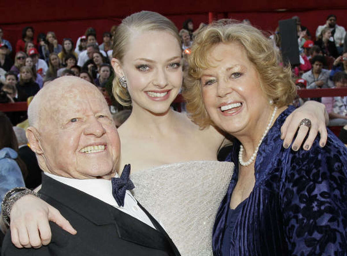 Mickey Rooney, Amanda Seyfried and Jan Rooney arrive at the 82nd Academy Awards.Actor Mickey Rooney died Sunday, April 6, 2014, at age 93.