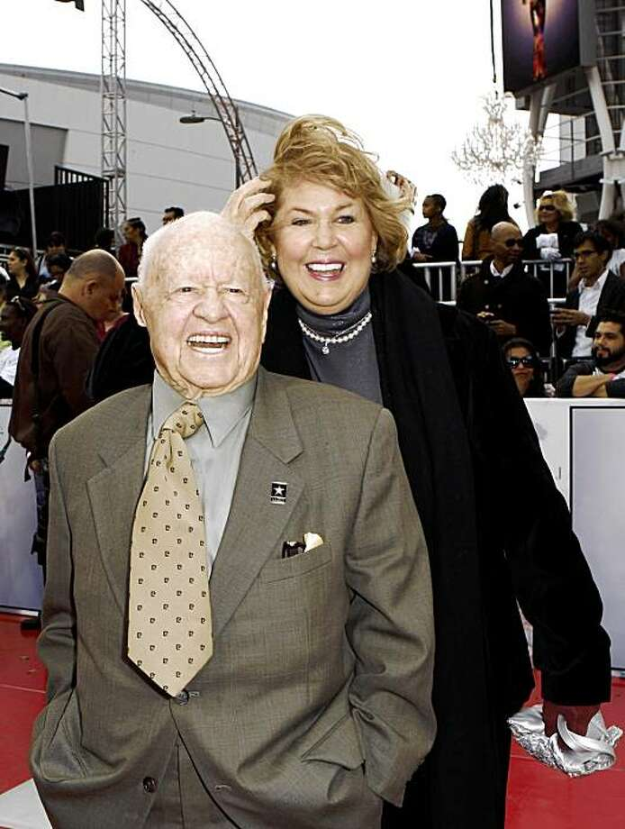 "Mickey Rooney, front, and Jan Chamberlin arrive to the premiere of Michael Jackson's ""This Is It,"" Tuesday, Oct. 27, 2009, in Los Angeles. Actor Mickey Rooney died Sunday, April 6, 2014, at age 93. Photo: Matt Sayles, AP"