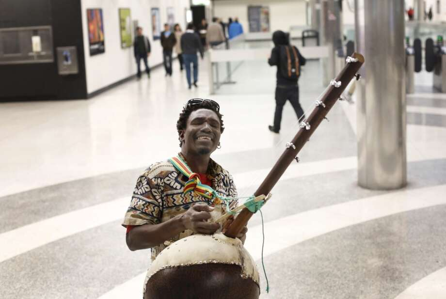 Originally from West Africa, Yacouba Diarra plays his handmade ngoni at the Powell Street BART station in San Francisco, Calif. Photo: Mike Kepka , The Chronicle