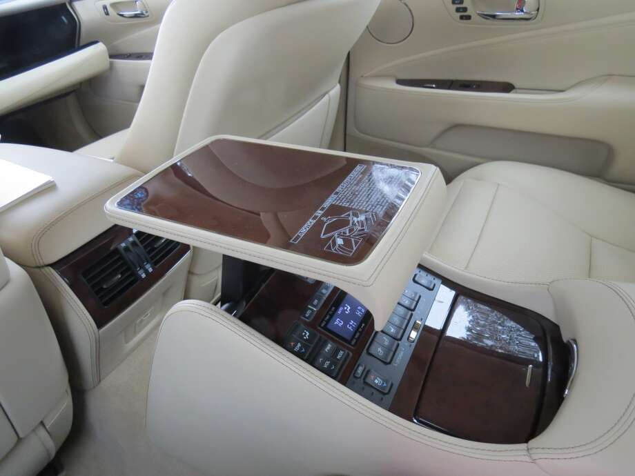 The rear-seat center console has a pop-up table for writing or, perhaps, a game of cards.