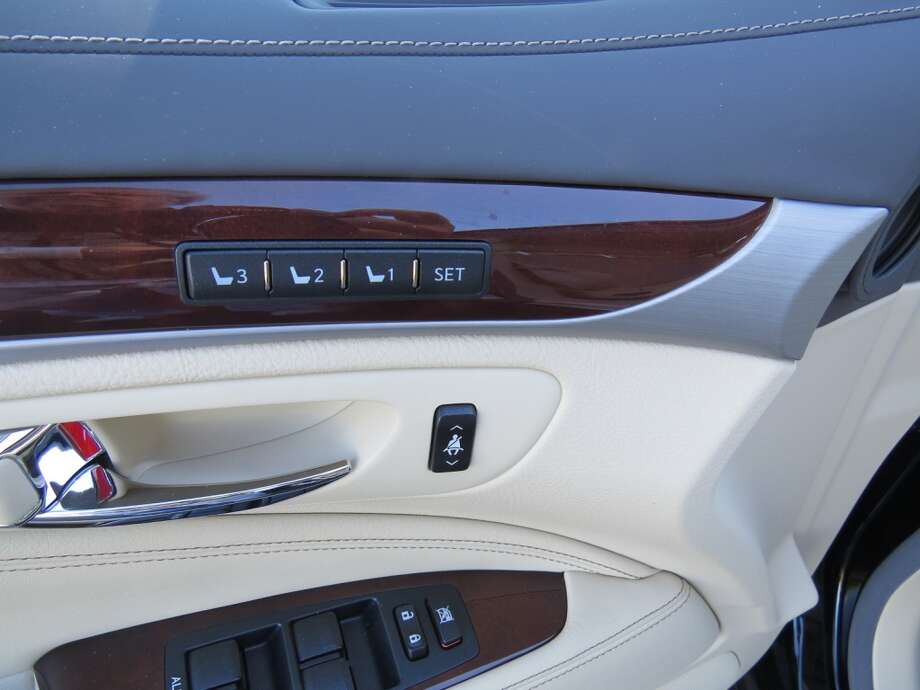 The small switch just ahead of the door handle raises or lowers the seat belt pulley from the B-pillar.