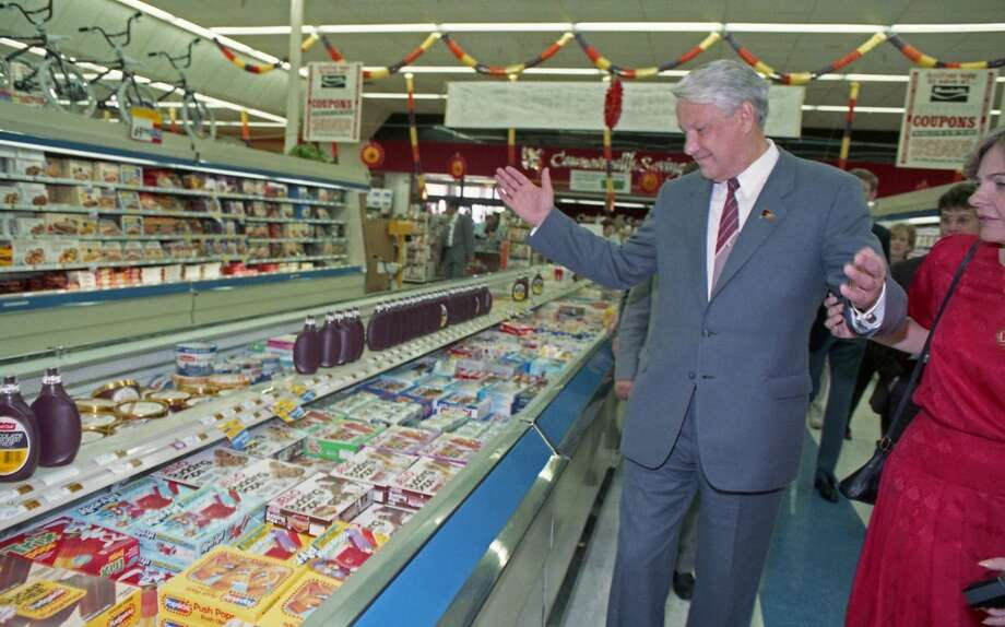 09/16/1989 - Boris Yeltsin and a handful of Soviet companions made an unscheduled 20-minute visit to a Randall's Supermarket after touring the Johnson Space Center. Between trying free samples of cheese and produce and staring at the meat selections, Yeltsin roamed the aisles of Randall's nodding his head in amazement. Photo: © Houston Chronicle