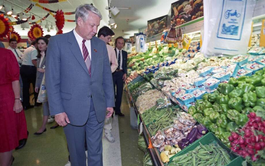 09/16/1989 - Boris Yeltsin and a handful of Soviet companions made an unscheduled 20-minute visit to a Randall's Supermarket after touring the Johnson Space Center. Between trying free samples of cheese and produce and staring at the frozen food selections, Yeltsin roamed the aisles of Randall's nodding his head in amazement. Photo: © Houston Chronicle