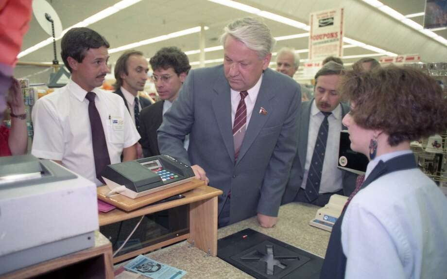 09/16/1989 - Boris Yeltsin and a handful of Soviet companions made an unscheduled 20-minute visit to a Randall's Supermarket after touring the Johnson Space Center.  At the check-out counter, an employee showed the Soviet politician how a computer scans each item and totals the bill automatically. Photo: © Houston Chronicle