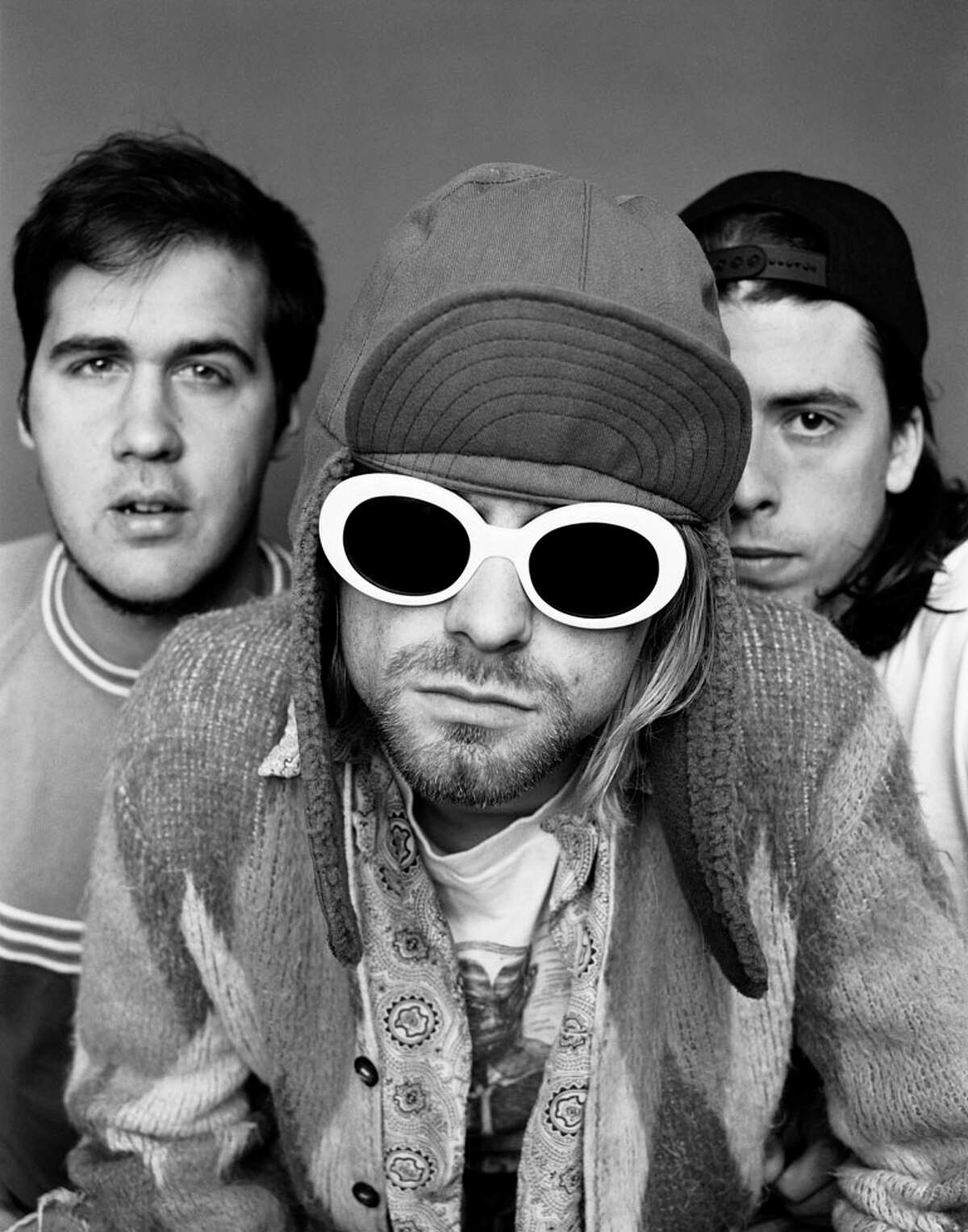 Kurt Cobain and Nirvana bandmates Dave Grohl and bassist Krist Novoselic posed for this shot for a London magazine in November 1993.
