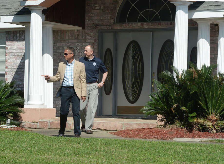 The FBI, Friday morning, searched the homes of Naomi Lawrence Lee BISD's purchasing director and William 'Bo' Kelley the former West Brook Booster Club president. Investigators are seen walking away from Lee's home. Photo taken Friday, April 04, 2014 Guiseppe Barranco/@spotnewsshooter Photo: Guiseppe Barranco, Photo Editor