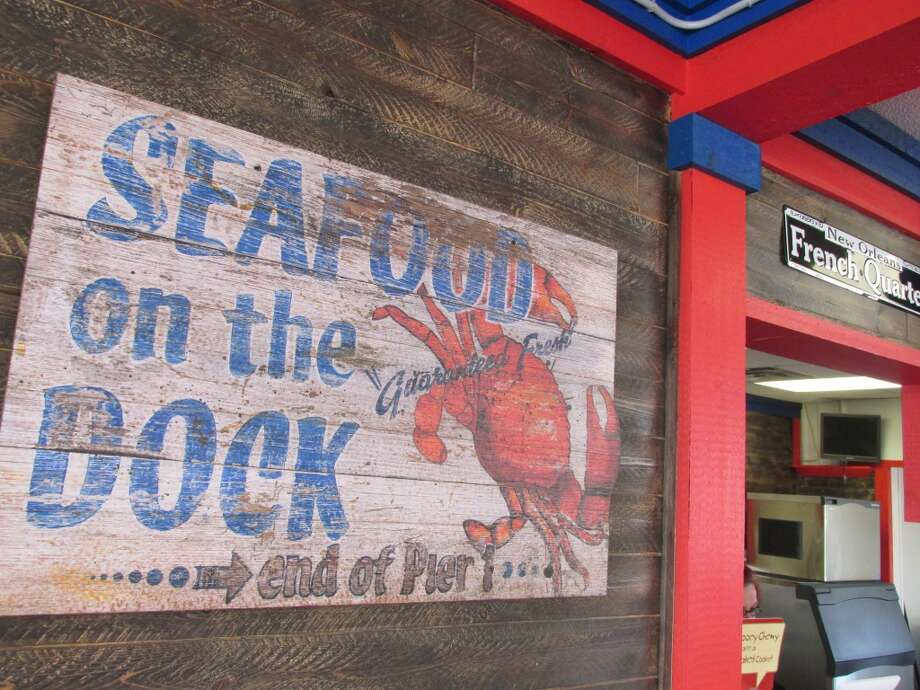 The interior and exterior of C. Diddy's Crawfish Shack in Vidor was designed by local businessman and owner Florentino Diaz and features custom tables and hand-painted elements. Photo: Cat5