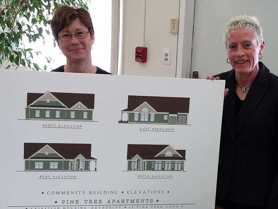 Carol J. Martin, right, executive director of the Fairfield Housing Authority, and Peggy Ford, the authority's resident service coordinator, hold a rendering of buildings proposed to replace the existing units at the Pine Tree Lane housing complex. Photo: Andrew Brophy / Fairfield Citizen