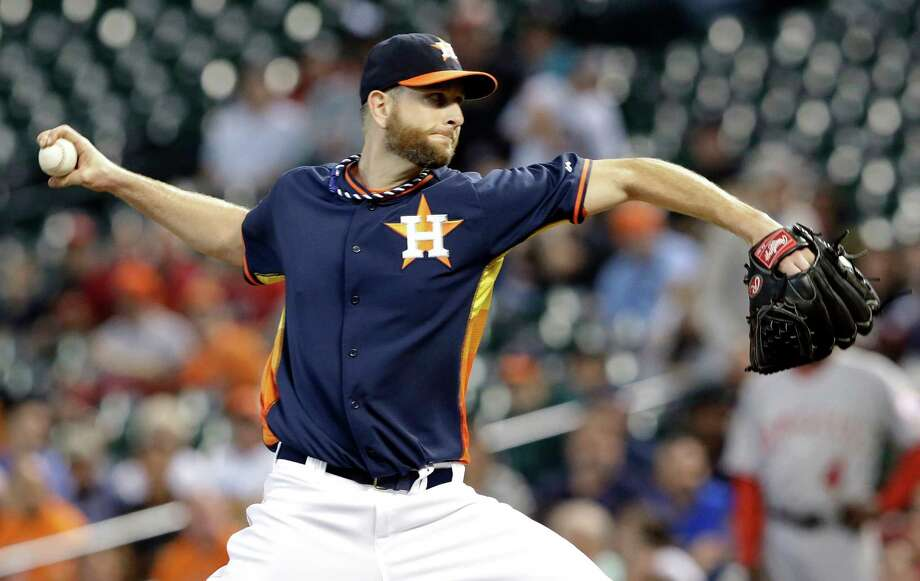 Houston Astros' Scott Feldman delivers a pitch against the Los Angeles Angels in the first inning of a baseball game on Sunday, April 6, 2014, in Houston. (AP Photo/Pat Sullivan) Photo: Pat Sullivan, Associated Press / AP
