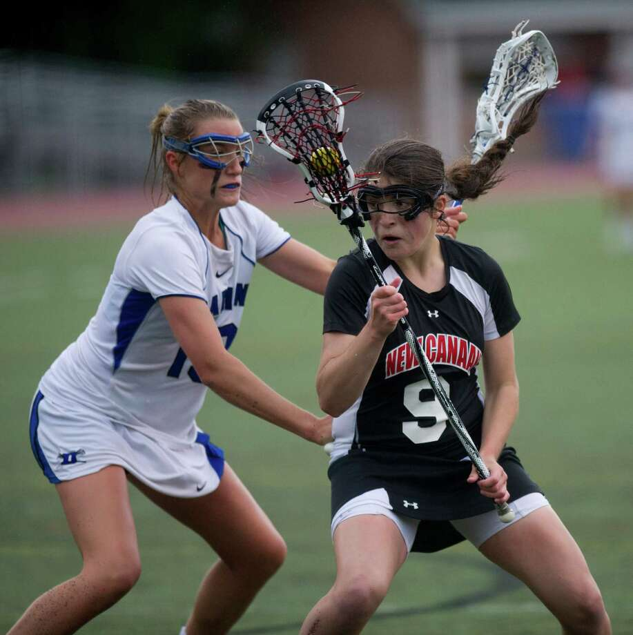 New Canaan's Isabel Taben carries the ball during the 2013 FCIAC girls lacrosse championship against Darien at Brien McMahon High School in Norwalk, on May 24, 2013. Photo: Lindsay Perry / Stamford Advocate