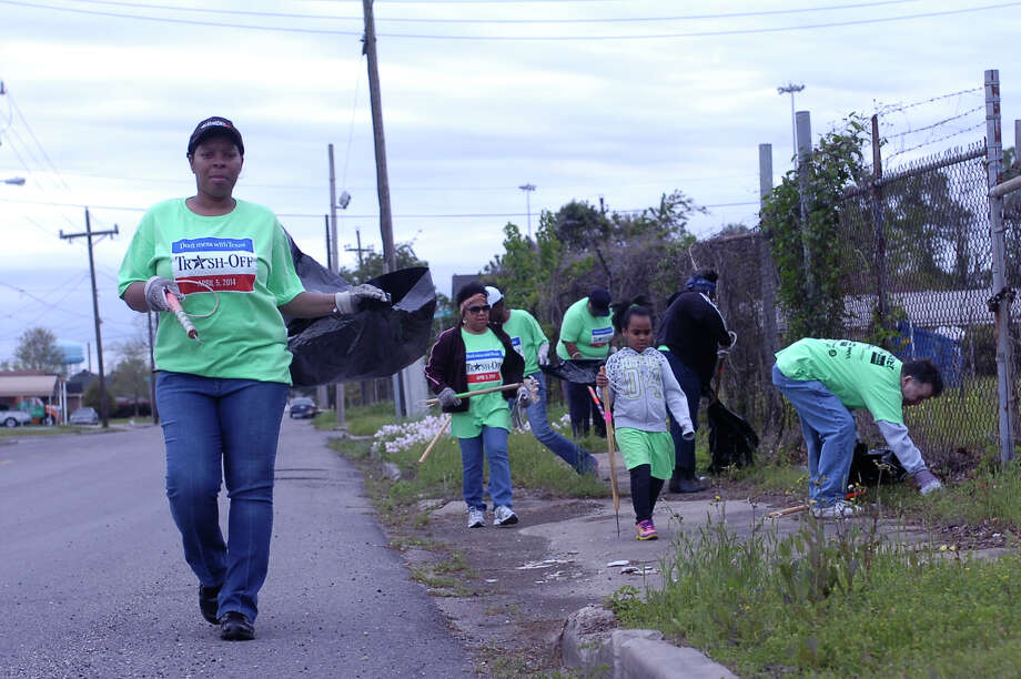 Mary Alexander, Ruth Poullard, Rachel Carmichael, Loretta Juneau, Livia Thibeaux, Thelma Johnson and Gary Tucker represented the Beaumont Health Department during the third annual citywide Trash Off. They were among 583 volunteers who picked up about 4.2 tons of garbage Saturday. Photo: Sarah Moore