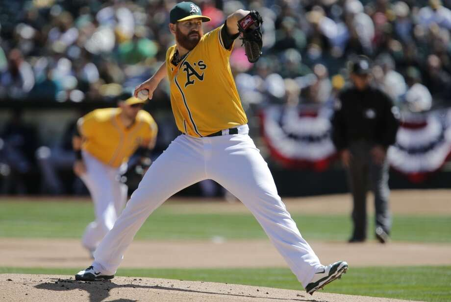 A's starting pitcher Dan Straily, (67) throws in the first innig, as the Oakland Athletics take on the Seattle Mariners at the O.co Coliseum on Saturday April 5, 2014, in Oakland, Calif. Photo: The Chronicle