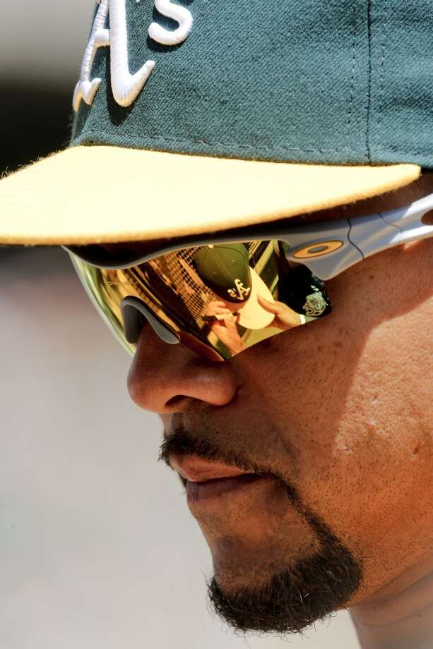 A's Coco Crisp, (4) signs autographs before the start of the game,  as the Oakland Athletics prepare to take on the Seattle Mariners at the O.co Coliseum on Saturday April 5, 2014, in Oakland, Calif. Photo: The Chronicle