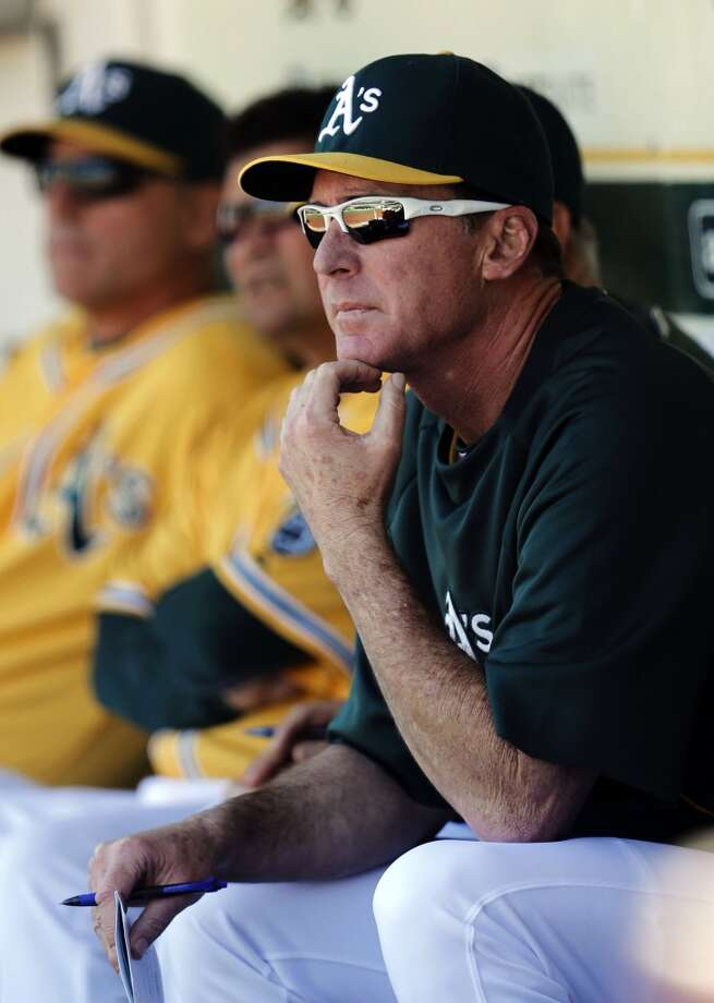 A's manager Bob Melvin watches late in the game from the dugout,  as the Oakland Athletics went on to lose to the Seattle Mariners 3-1 at the O.co Coliseum on Saturday April 5, 2014, in Oakland, Calif. Photo: The Chronicle