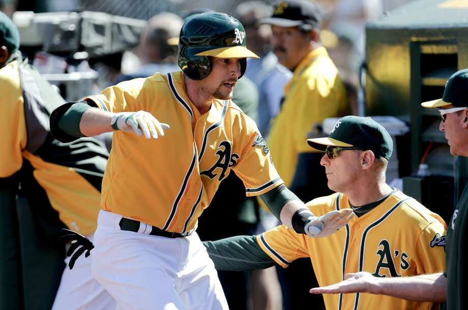 A's Jed Lowrie, (8) gave the team a spark in the bottom of the 9th inning with a solo home run, as the Oakland Athletics went on to lose to the Seattle Mariners 3-1 at the O.co Coliseum on Saturday April 5, 2014, in Oakland, Calif. Photo: The Chronicle