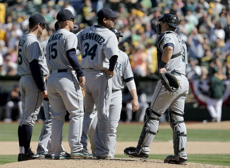 Mariners' starting pitcher Felix Hernandez, (34) nearly pitched the entire game coming out in the bottom of the 9th inning, as the Oakland Athletics beaten by the Seattle Mariners 3-1 at the O.co Coliseum on Saturday April 5, 2014, in Oakland, Calif. Photo: The Chronicle