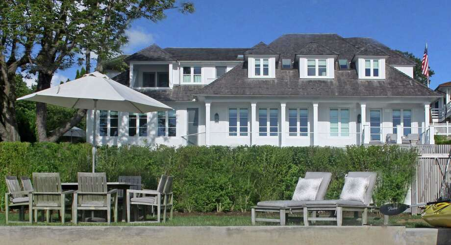 The house at 248 Hillspoint Road -- shown from a waterfront perspective -- is on the market for $5,850,000. Photo: Contributed Photo / Westport News