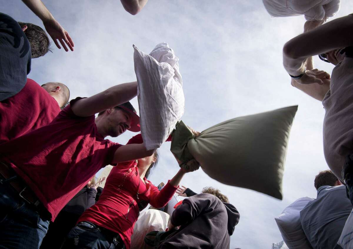 People hit each other with pillows during an event dubbed International Pillow Fight Day next to the Washington Monument in Washington on April 5, 2014. The event, which was created in 2008, claims worldwide participation of over 80 cities for the 2014 edition. AFP PHOTO/MLADEN ANTONOVMLADEN ANTONOV/AFP/Getty Images