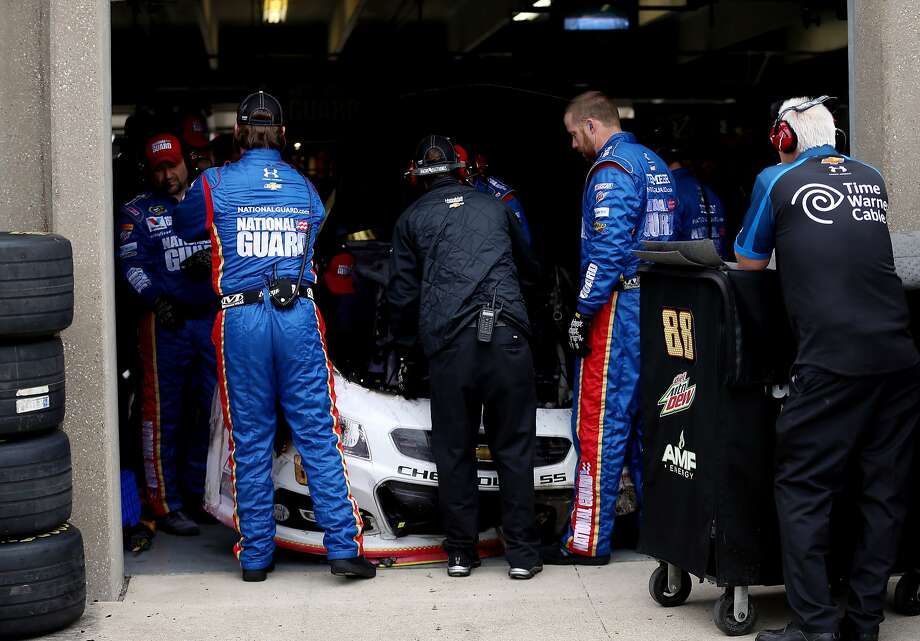 FORT WORTH, TX - APRIL 07:  Crew members work on the #88 National Guard Chevrolet of Dale Earnhardt Jr. in the garage area after he crashed early in the NASCAR Sprint Cup Series Duck Commander 500 at Texas Motor Speedway on April 7, 2014 in Fort Worth, Texas.  (Photo by Chris Graythen/Getty Images for Texas Motor Speedway) Photo: Chris Graythen, (Credit Too Long, See Caption)
