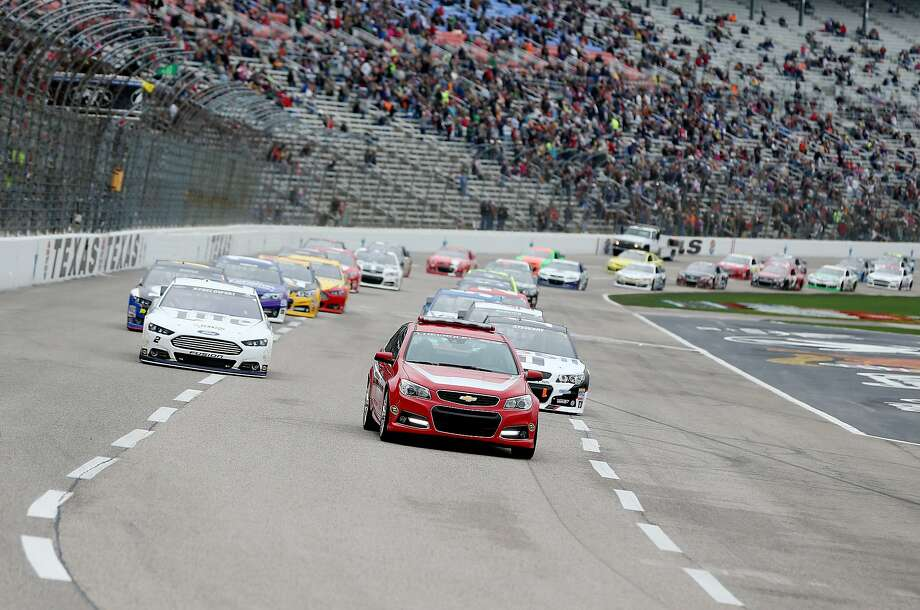 FORT WORTH, TX - APRIL 07:  The pace car leads the field under a yellow/green flag start to the NASCAR Sprint Cup Series Duck Commander 500 at Texas Motor Speedway on April 7, 2014 in Fort Worth, Texas.  (Photo by Jeff Gross/Getty Images for Texas Motor Speedway) Photo: Jeff Gross, (Credit Too Long, See Caption)