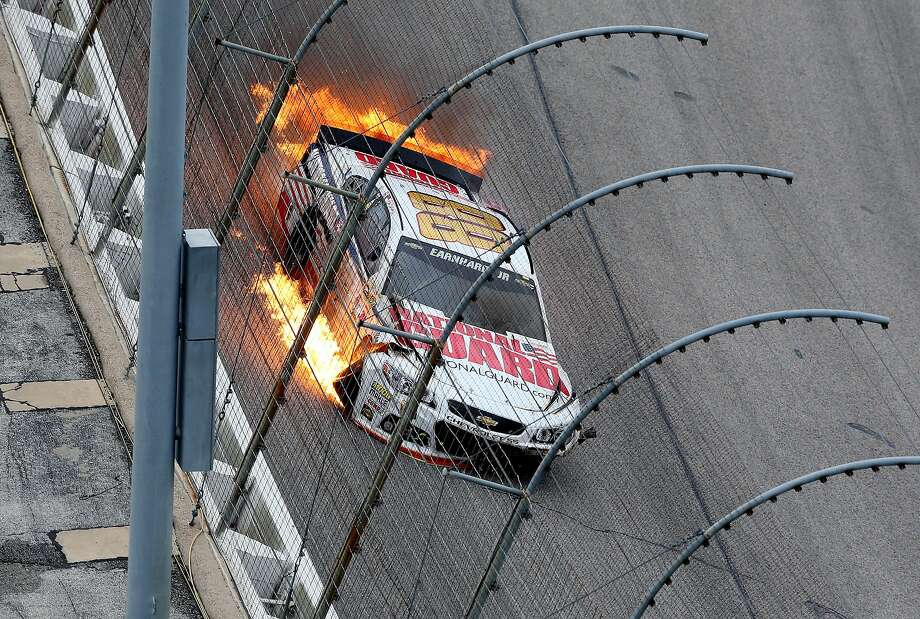 FORT WORTH, TX - APRIL 07:  Dale Earnhardt Jr., driver of the #88 National Guard Chevrolet, crashes early in the NASCAR Sprint Cup Series Duck Commander 500 at Texas Motor Speedway on April 7, 2014 in Fort Worth, Texas.  (Photo by Nick Laham/Getty Images for Texas Motor Speedway) Photo: Nick Laham, (Credit Too Long, See Caption)