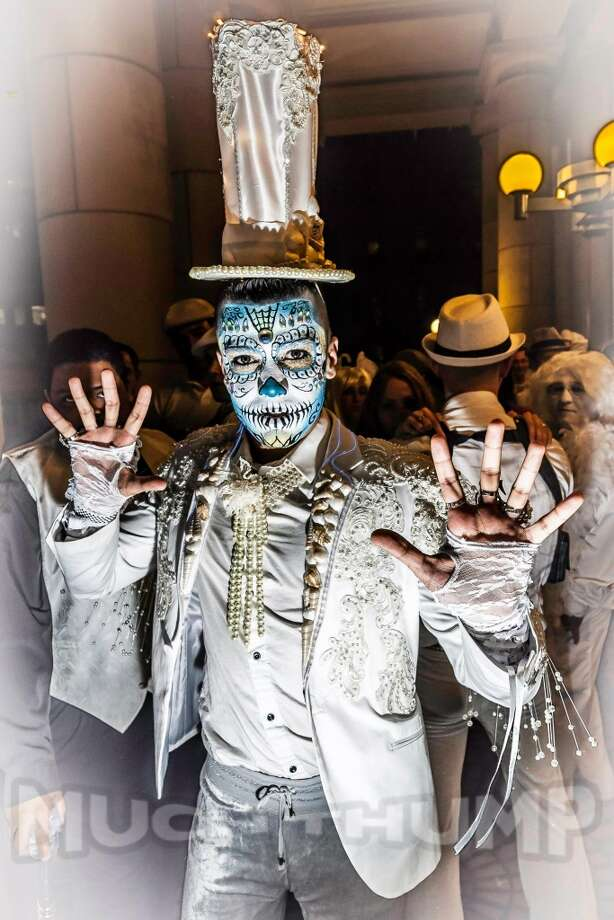 A costumed reveler shows off his intricate skeleton face painting. Photo: Courtesy Opulent Temple