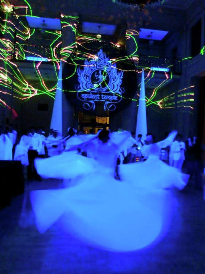 Sufi dancers spin in white. Photo: Courtesy Opulent Temple