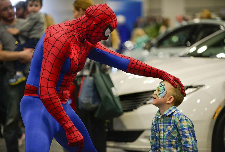 Can I be your Robin-like sidekick?Spider-Man meets a masked admirer (4-year old Landon Tisdale) at the Central Illinois Auto Show in 
