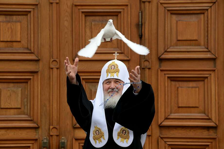 Off you go! Russian Orthodox Patriarch Kirill releases a white dove to mark Annunciation Day at the 