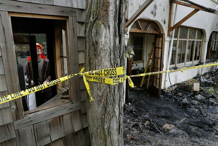 Joel Main assesses damage at the Wilbur Hot Springs lodge last week, days after the fire. Photo: Michael Macor, The Chronicle
