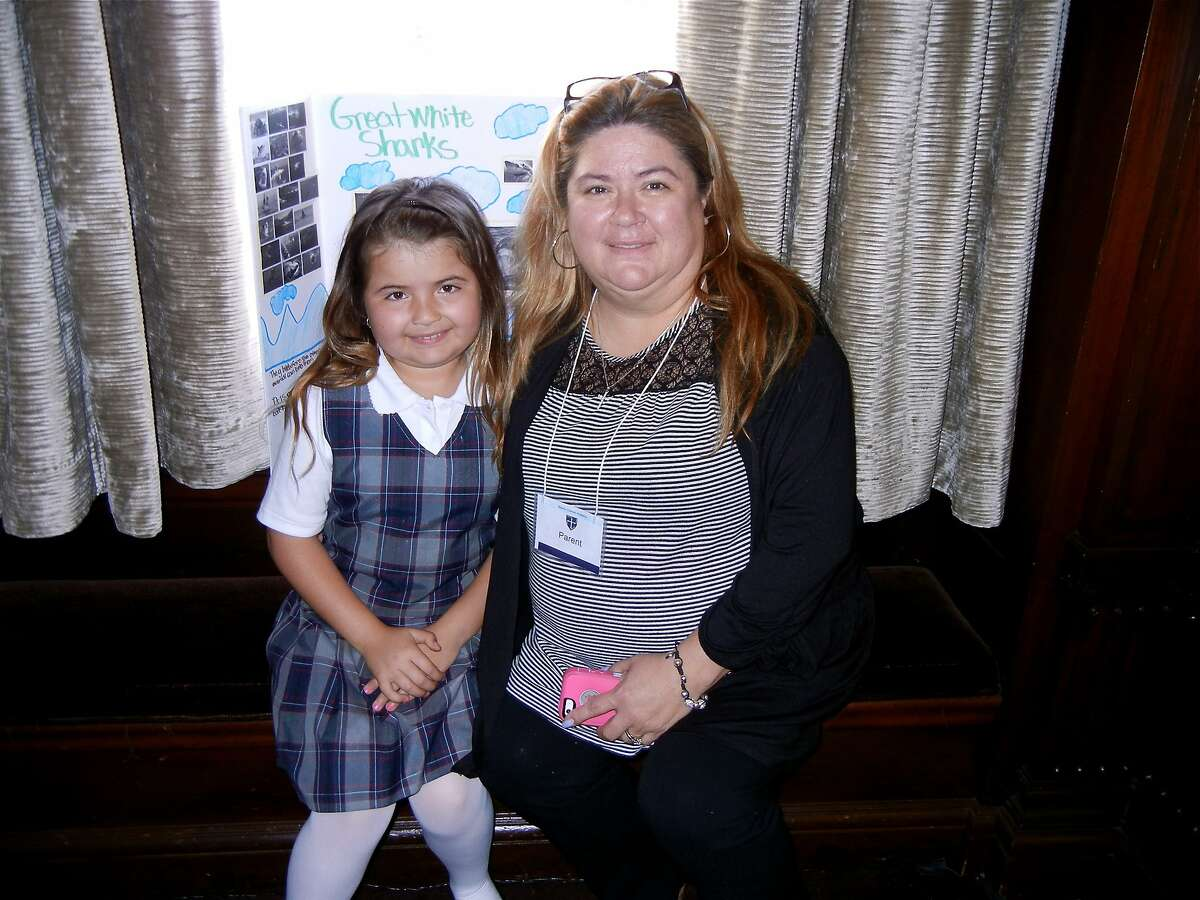 Mission Dolores Academy student Andi Flores (at left) with her mom, JoAnne Flores, in the Julia Morgan Ballroom during the Mission Dolores Academy Chef's Luncheon fundraiser. April 2014. By Catherine Bigelow.