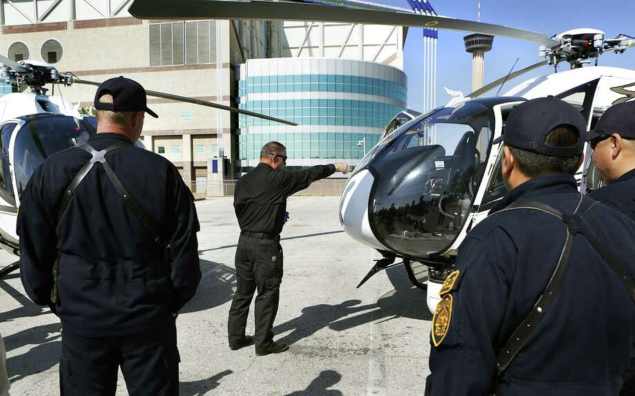 The San Antonio Police Department Chaplain Paul Worley uses Holy Water to bless the department's two new helicopters, the Airbus EC120s, that were unveiled  in an Alamodome parking lot.  Monday, April 7, 2014. Photo: BOB OWEN, San Antonio Express-News / © 2012 San Antonio Express-News