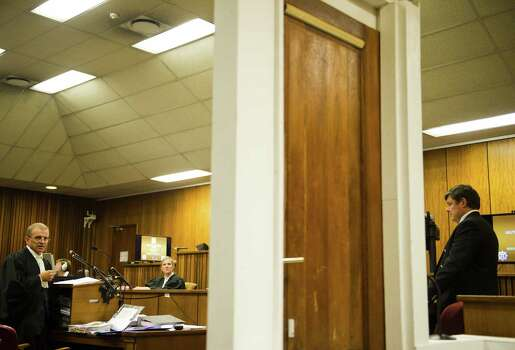 The bathroom door from Oscar Pistorius' home was a key piece of evidence in his murder trial. The angle of gunshots would determine whether he was standing with prosthetic legs, forensic experts said, indicating premeditated murder. • 'She died in my arms' Photo: Alet Pretorius, Houston Chronicle / POOL media 24