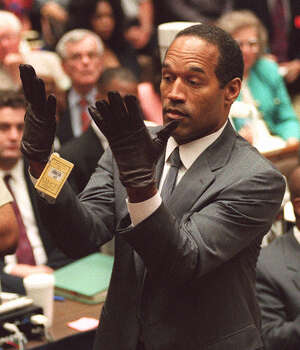 """'Trial of the century' Besides introducing a riveted TV audience to DNA analysis, O.J. Simpson's 1995 murder trial in the deaths of his ex-wife and her friend hinged on a pair of gloves. Defense lawyer Johnnie Cochran famously summed up evidence: """"If it doesn't fit, you must acquit.""""  • Book alleges O.J. confessed while high on pot Photo: VINCE BUCCI, Houston Chronicle / AGENCE FRANCE PRESSE POOL"""