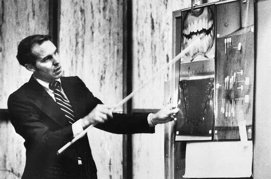 Bite fits the crime Expert witness Dr. Richard Souviron, during the Miami trial in July 1979, ties serial killer Ted Bundy's teeth to bite marks on the buttocks of a slain co-ed.  • DNA could clear a 50-year-old case Photo: Uncredited, Houston Chronicle / AP