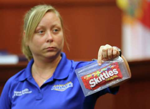 Skittles, tea and a hoodie Diana Smith, crime scene technician for the Sanford, Fla. Police Department, shows Skittles collected in the 2012 shooting death of teen Trayvon Martin by George Zimmerman in Florida. • Two sides in Houston clash over the verdict. Photo: Gary W. Green, Houston Chronicle / Pool Orlando Sentinel