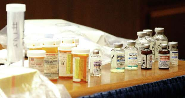 Pills killed pop star Drugs found in the home of pop star Michael Jackson sit on the prosecution's table after being introduced as evidence against Dr. Conrad Murray on Oct. 5, 2011.  • Murray denied a rehearing Photo: Pool, Houston Chronicle / 2011 Getty Images