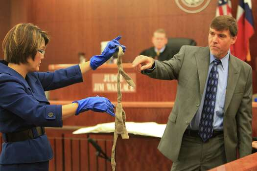 Assistant Harris County District Attorney Connie Spence and Deputy Chief Medical Examiner Dwayne Wolf show the liggit Susan Wright used to tie her husband, Jeffrey, to their bed before stabbing him nearly 200 times.