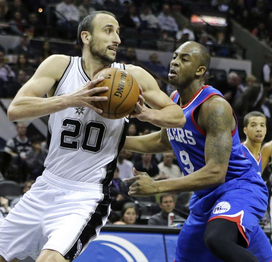 San Antonio Spurs' Manu Ginobili looks for room around Philadelphia 76ers' James Anderson during first half action Monday March 24, 2014 at the AT&T Center. Photo: Edward A. Ornelas, San Antonio Express-News
