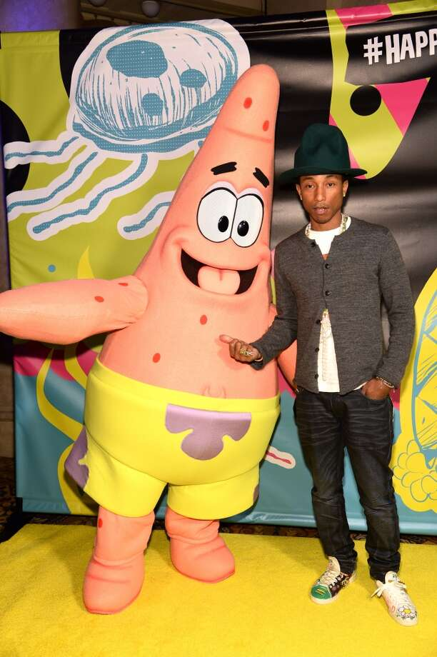 Pharrell Williams poses with Patrick at the SpongeBob SquarePants themed, 41st birthday party for Pharrell Williams at Bikini Bottom at Cipriani Wall Street on April 4, 2014 in New York City. Photo: Dimitrios Kambouris, Getty Images For Nickelodeon